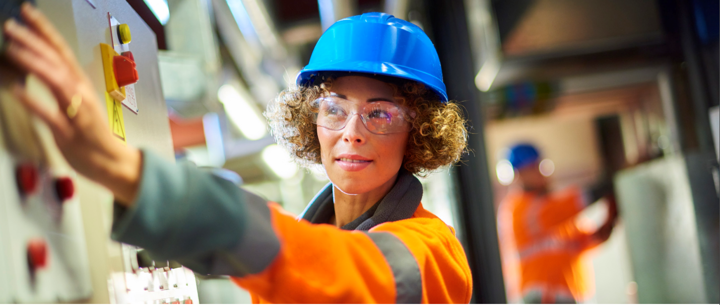 Utility worker female with blue helmet